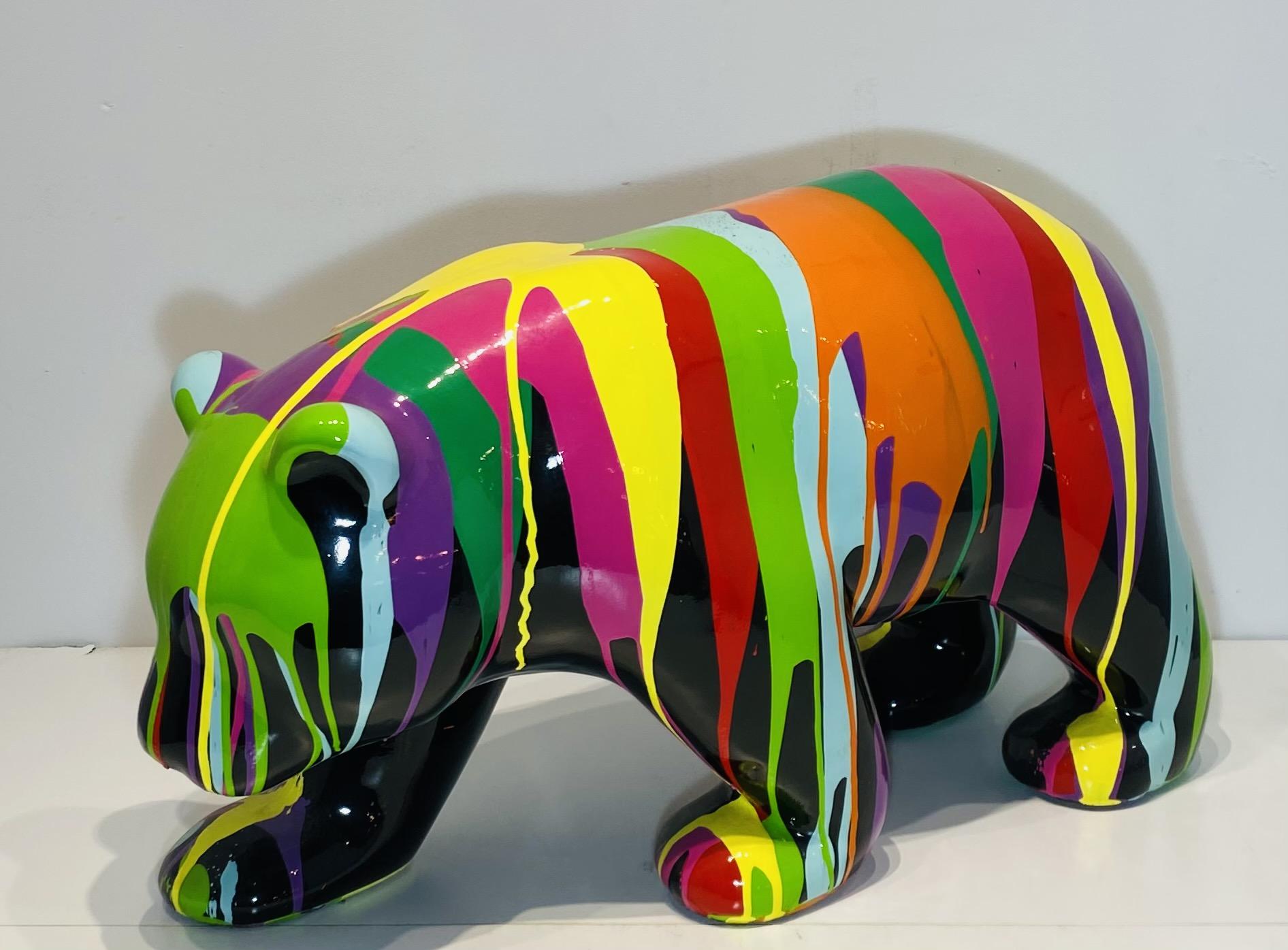 ours en résine personnalisé par des coulures de peinture